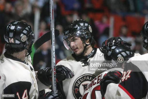 Joey Ryan of the Quebec Remparts celebrates with teammates during the game against the Halifax Mooseheads on February 18, 2006 at the Halifax Metro...