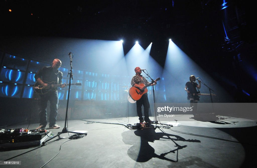 Joey Santiago, Black Francis and Kim Shattuck of The Pixies perform live on stage on Day 25 of iTunes Festival 2013 at The Roundhouse on September 25, 2013 in London, England.