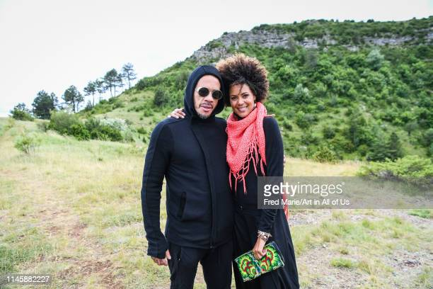 Joey starr and sophie ducasse taking pictures before a bungee jump session from a cliff, Occitanie, Florac, France on July 2, 2017 in Florac, France.