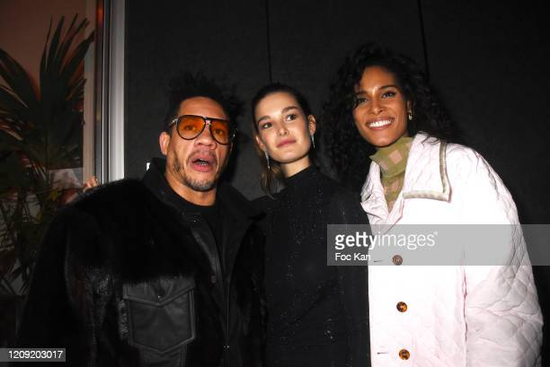 Joey Starr Ophelie Guillermand Joey Starr and Cindy Bruna attend Women to Women Auction Party at les Bains on February 27 2020 in Paris France
