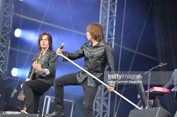 Joey Tempest and John Leven of Swedish hard rock group Europe performing live on the Zippo Encore Stage at Download Festival on June 14 2013