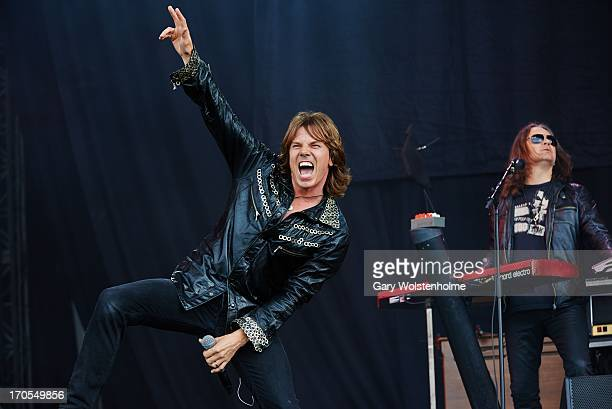 Joey Tempest and Mic Michaeli of Europe perform on stage on Day 1 of Download Festival 2013 at Donnington Park on June 14 2013 in Donnington England