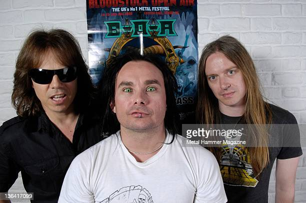 Joey Tempest Dani Filth and Bill Steer posing with a poster for Bloodstock Festival 2009 During a portrait shoot on June 24 2009