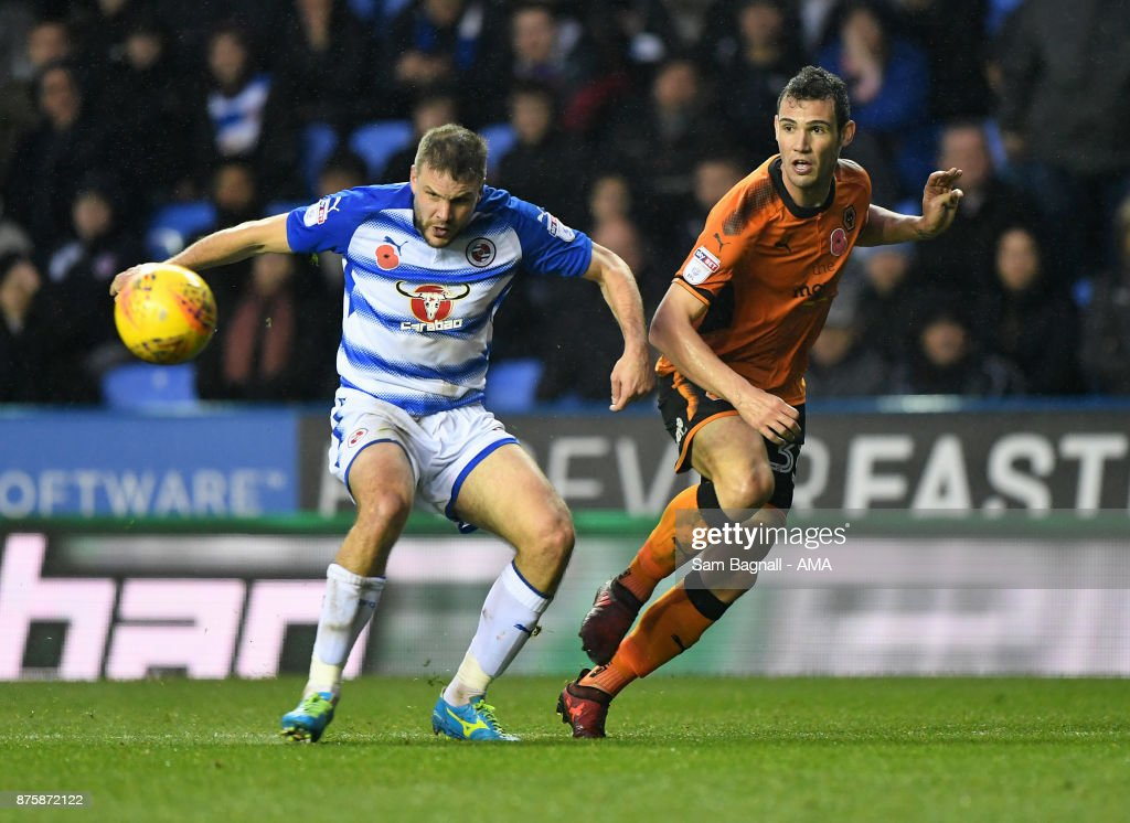 Joey van Den Berg of Reading and Leo Bonatini of Wolverhampton Wanderers during the Sky Bet Championship match between Reading and Wolverhampton at Madejski Stadium on November 18, 2017 in Reading, England.