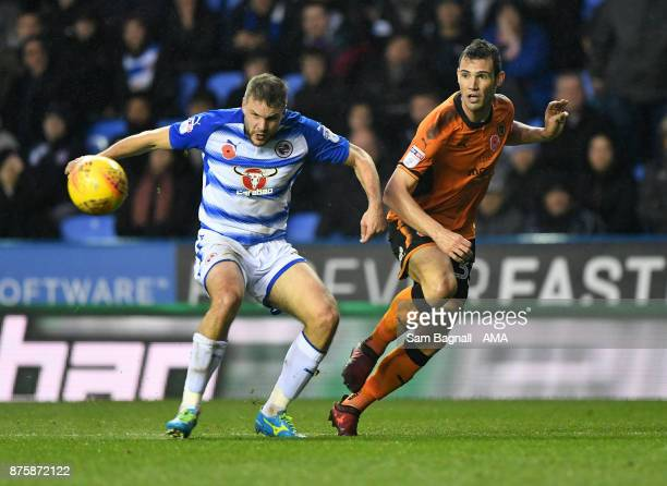 Joey van Den Berg of Reading and Leo Bonatini of Wolverhampton Wanderers during the Sky Bet Championship match between Reading and Wolverhampton at...
