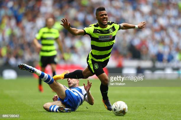 Joey van den Berg of Reading fouls Elias Kachunga of Huddersfield Town during the Sky Bet Championship play off final between Huddersfield and...