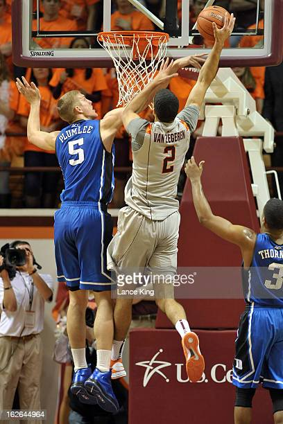 Joey Van Zegere of the Virginia Tech Hokies goes to the hoop against Mason Plumlee of the Duke Blue Devils at Cassell Coliseum on February 21 2013 in...