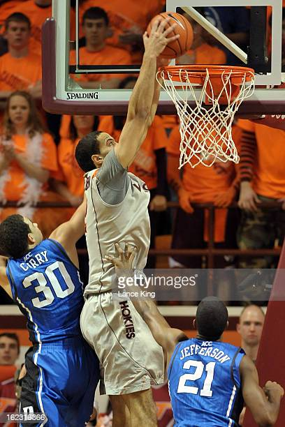 Joey Van Zegere of the Virginia Tech Hokies goes up for a dunk against Seth Curry and Amile Jefferson of the Duke Blue Devils at Cassell Coliseum on...