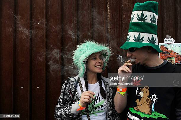 Joey Vasselo right and Katlyn Sampson take a moment to smoke a joint at 420 during the High Times US Cannabis Cup at the Exdo Center on April 20 2013...