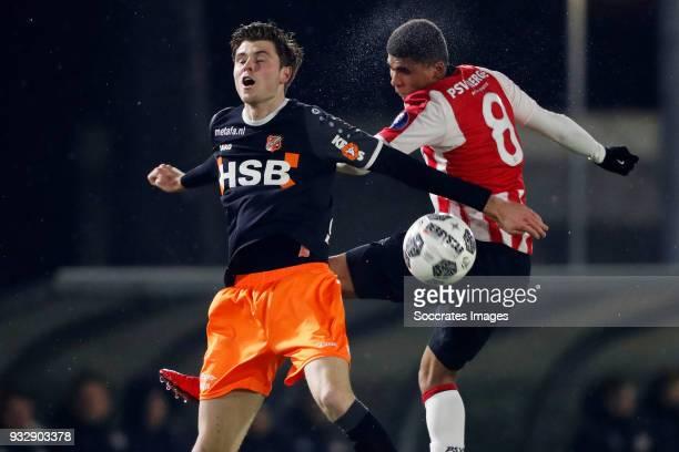 Joey Veerman of FC Volendam Laros Duarte of PSV U23 during the Dutch Jupiler League match between PSV U23 v FC Volendam at the De Herdgang on March...