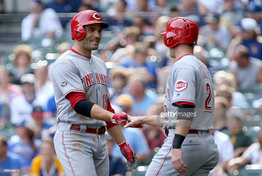 Joey Votto #19 and Zack Cozart #2 of the Cincinnati Reds celebrate after Votto hit a home run in the eighth inning against the Milwaukee Brewers at Miller Park on August 14, 2016 in Milwaukee, Wisconsin.