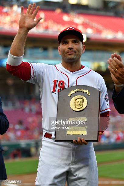 Joey Votto of the Cincinnati Reds accepts the Lou Gehrig Memorial Award before a game against the Philadelphia Phillies at Great American Ball Park...