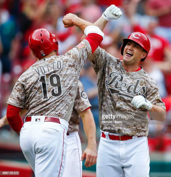 Joey Votto of the Cincinnati Reds and Scott Schebler of the Cincinnati Reds celebrate after Schebler hit a threerun homer in the sixth inning to go...