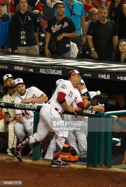 Joey Votto of the Cincinnati Reds and the National League fails to make a catch in foul territory in the eighth inning against the American League...