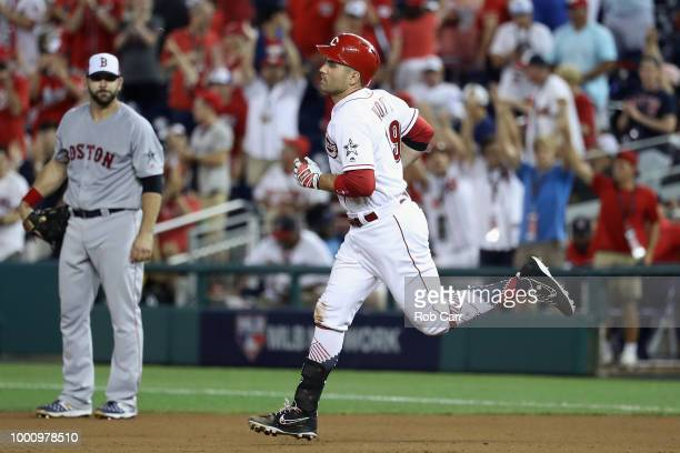 Joey Votto of the Cincinnati Reds and the National League reacts after hitting a solo home run in the tenth inning against the American League during...