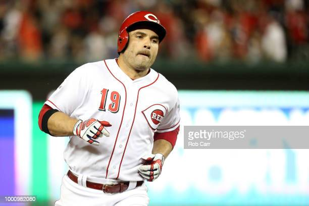 Joey Votto of the Cincinnati Reds and the National League rounds the bases after hitting a solo home run in the tenth inning against the American...