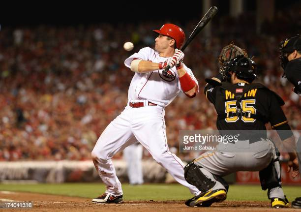 Joey Votto of the Cincinnati Reds backs away from a high inside pitch in the seventh inning against the Pittsburgh Pirates at Great American Ball...