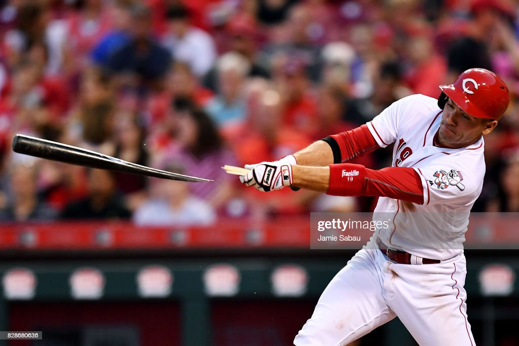 Joey Votto #19 of the Cincinnati Reds breaks his bat on a single in the fourth inning against the San Diego Padres at Great American Ball Park on August 9, 2017 in Cincinnati, Ohio.