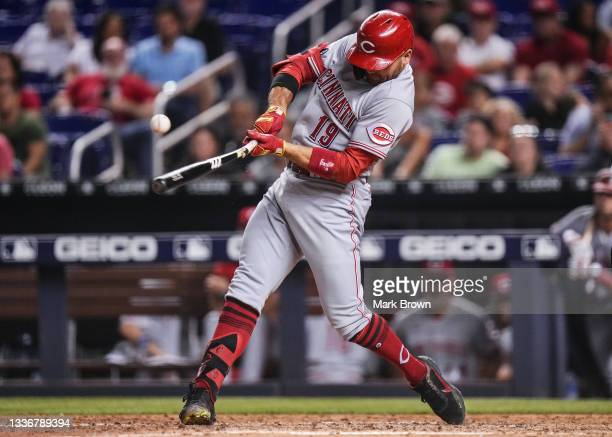 Joey Votto of the Cincinnati Reds breaks hit bat after hitting a line drive in the eighth inning against the Miami Marlins at loanDepot park on...