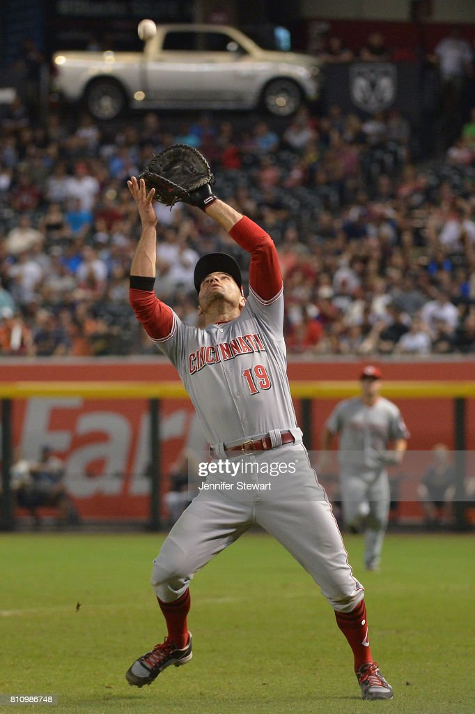 Joey Votto #19 of the Cincinnati Reds catches a foul ball during the seventh inning of the MLB game against the Arizona Diamondbacks at Chase Field on July 8, 2017 in Phoenix, Arizona.