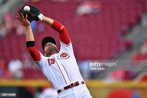 Joey Votto of the Cincinnati Reds catches a foul ball in the first inning against the New York Mets at Great American Ball Park on September 6 2016...