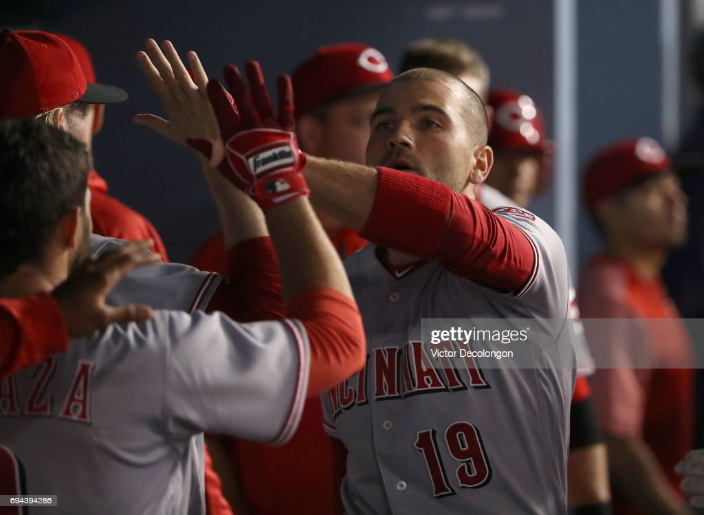 Joey Votto #19 of the Cincinnati Reds celebrates a late game homerun with teammates in the dugout in the ninth inning of the MLB game against the Los Angeles Dodgers at Dodger Stadium on June 9, 2017 in Los Angeles, California. The Dodgers defeated the Reds 7-2.