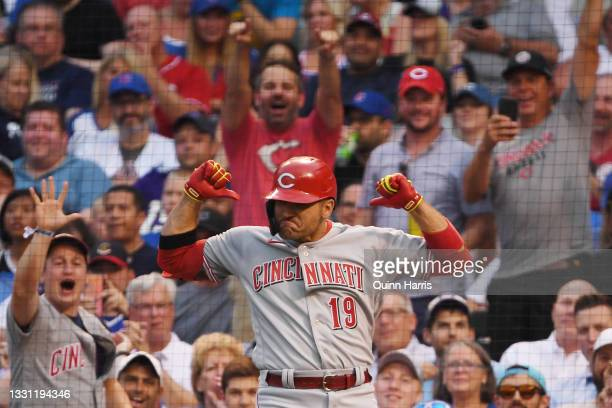 Joey Votto of the Cincinnati Reds celebrates after his home run in the second inning against the Chicago Cubs at Wrigley Field on July 28, 2021 in...