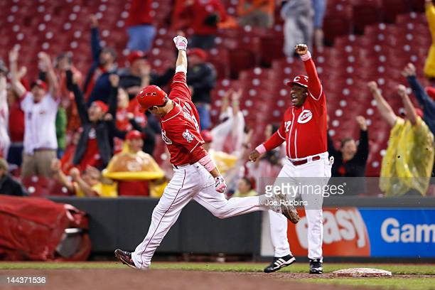 Joey Votto of the Cincinnati Reds celebrates after hitting a grand slam in the ninth inning against the Washington Nationals at Great American Ball...