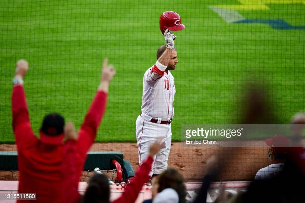 Joey Votto of the Cincinnati Reds celebrates his 300th career home run in the third inning during their game against the Chicago Cubs at Great...