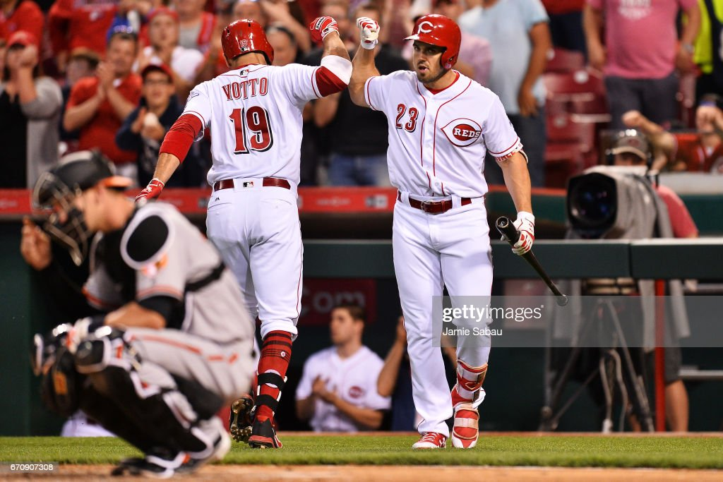 Joey Votto #19 of the Cincinnati Reds celebrates with Adam Duvall #23 of the Cincinnati Reds after hitting a solo home run in the fourth inning against the Baltimore Orioles at Great American Ball Park on April 20, 2017 in Cincinnati, Ohio. Baltimore defeated Cincinnati 2-1 in 10 innings.