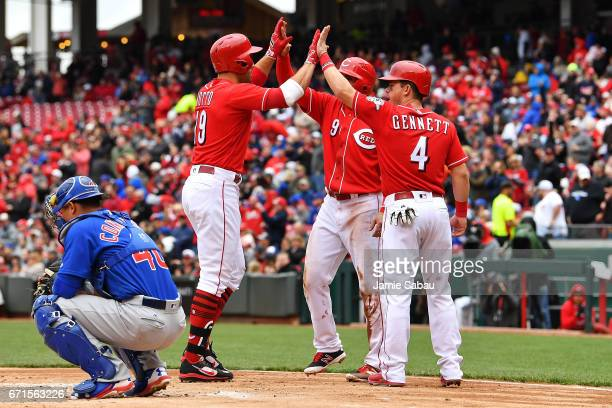 Joey Votto of the Cincinnati Reds celebrates with Jose Peraza of the Cincinnati Reds and Scooter Gennett of the Cincinnati Reds after hitting a...