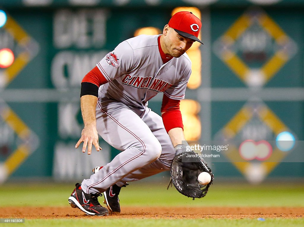 Joey Votto #19 of the Cincinnati Reds fields a ground ball in the 6th inning against the Pittsburgh Pirates during the game at PNC Park on October 3, 2015 in Pittsburgh, Pennsylvania.