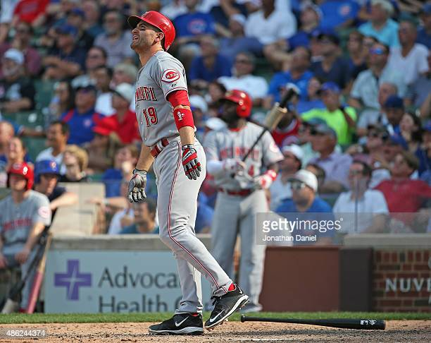 Joey Votto of the Cincinnati Reds follows the flight of his threerun home run in the 9th inning to beat the Chicago Cubs at Wrigley Field on...