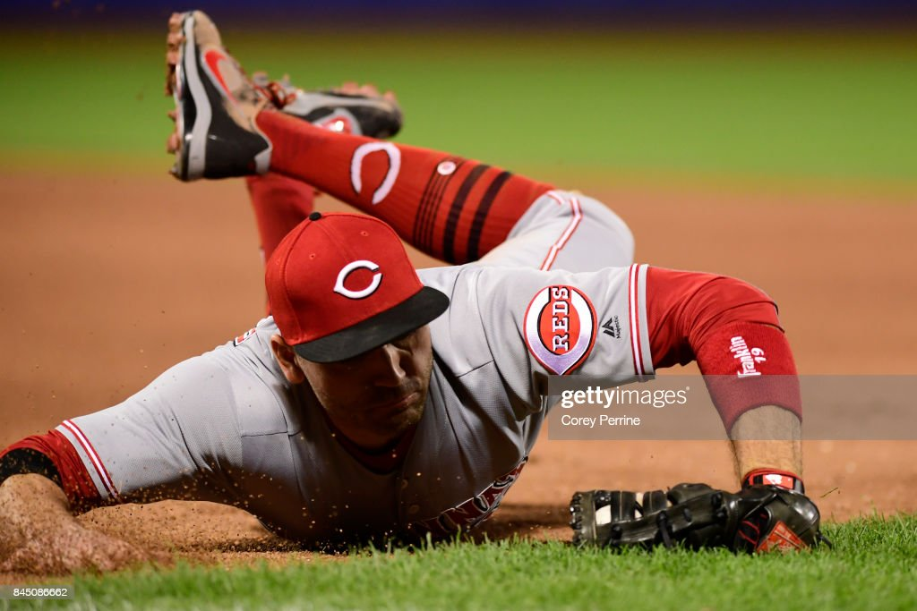 Joey Votto #19 of the Cincinnati Reds grabs an out off a line drive against the New York Mets during the eighth inning at Citi Field on September 9, 2017 in the Flushing neighborhood of the Queens borough of New York City. The Mets won 6-1.