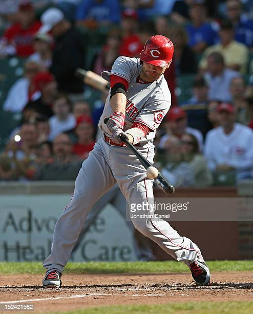 Joey Votto of the Cincinnati Reds hits a pinchhit runscoring single in the 7th inning against the Chicago Cubs at Wrigley Field on September 20 2012...
