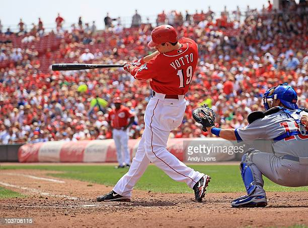 Joey Votto of the Cincinnati Reds hits a single during the game against the Chicago Cubs at Great American Ball Park on August 29 2010 in Cincinnati...
