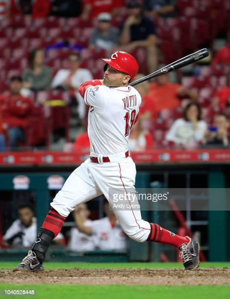 Joey Votto of the Cincinnati Reds hits a single in the eigth inning against the Kansas City Royals at Great American Ball Park on September 25 2018...