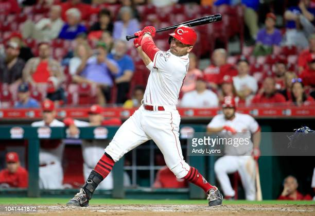 Joey Votto of the Cincinnati Reds hits a single in the ninth inning against the Kansas City Royals at Great American Ball Park on September 26 2018...