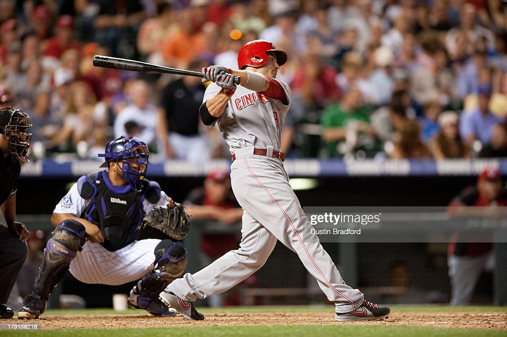 Joey Votto #19 of the Cincinnati Reds hits a sixth inning RBI single against the Colorado Rockies at Coors Field on August 31, 2013 in Denver, Colorado. The Reds beat the Rockies 8-3.