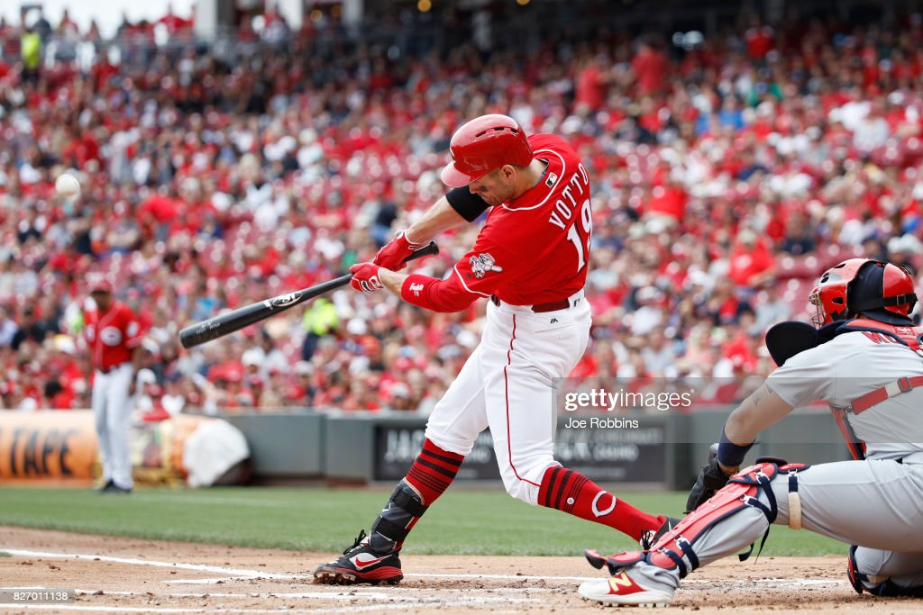 Joey Votto #19 of the Cincinnati Reds hits a three-run home run in the first inning of a game against the St. Louis Cardinals at Great American Ball Park on August 6, 2017 in Cincinnati, Ohio.