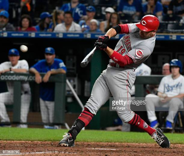 Joey Votto of the Cincinnati Reds hits a threerun triple in the 10th inning against the Kansas City Royals at Kauffman Stadium on June 12 2018 in...