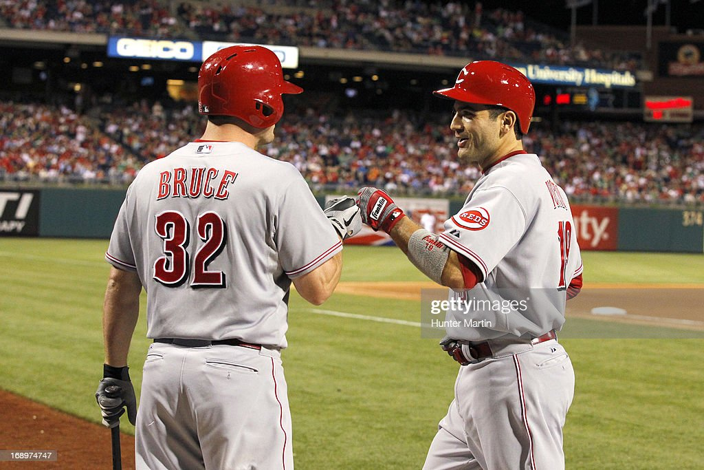 Joey Votto #19 of the Cincinnati Reds is congratulated by Jay Bruce #32 after hitting a solo home run in the eighth inning during a game against the Philadelphia Phillies at Citizens Bank Park on May 17, 2013 in Philadelphia, Pennsylvania. The Phillies won 5-3.