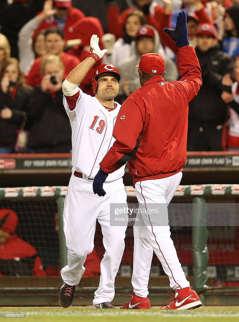 Joey Votto #19 of the Cincinnati Reds is congratulated by manager Dusty Baker after hiting the game winning single to drive in a run in the ninth inning against the Los Angeles Angels of Anaheim at Great American Ball Park on April 3, 2013 in Cincinnati, Ohio. The Reds won 5-4.