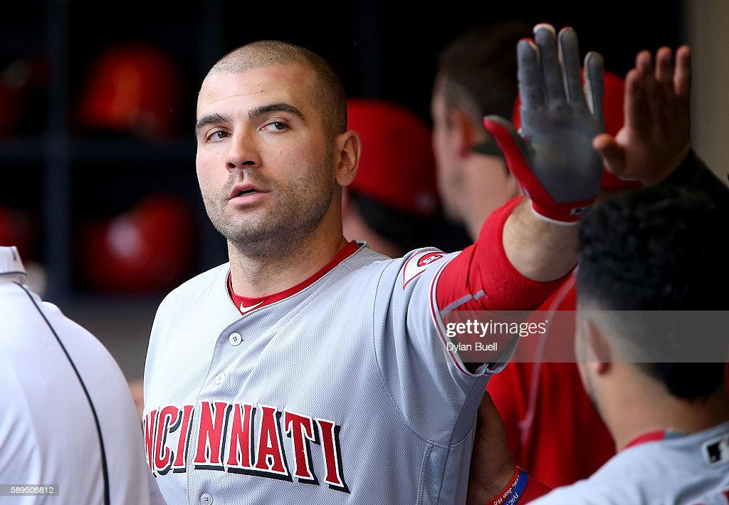 Joey Votto #19 of the Cincinnati Reds is congratulated by teammates after hitting a home run in the eighth inning against the Milwaukee Brewers at Miller Park on August 14, 2016 in Milwaukee, Wisconsin.