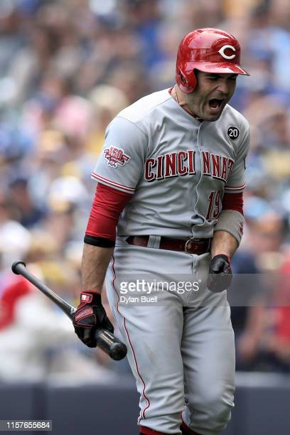 Joey Votto of the Cincinnati Reds reacts after striking out in the third inning against the Milwaukee Brewers at Miller Park on June 22, 2019 in...