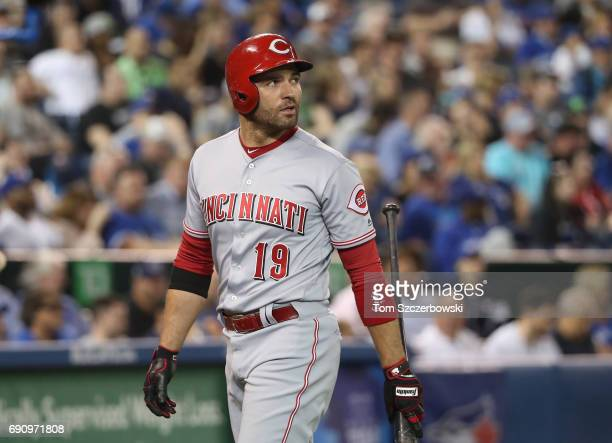 Joey Votto of the Cincinnati Reds reacts after striking out in the eighth inning during MLB game action against the Toronto Blue Jays at Rogers...