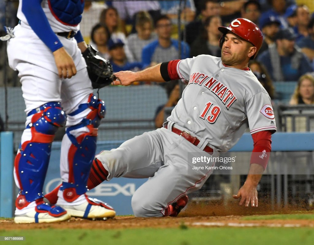 Joey Votto #19 of the Cincinnati Reds scores from first base on a double by Scooter Gennett #3 of the Cincinnati Reds in the fourth inning of the game against the Los Angeles Dodgers at Dodger Stadium on May 10, 2018 in Los Angeles, California.