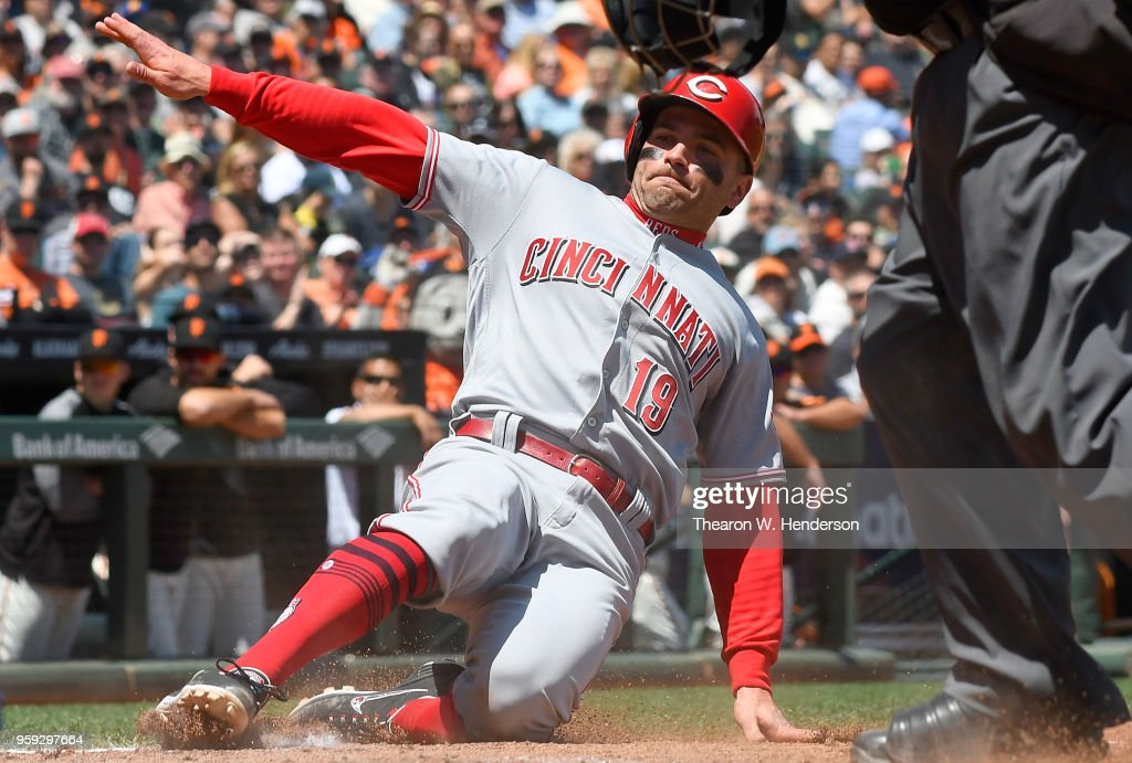 Joey Votto #19 of the Cincinnati Reds scores on a pass ball by catcher Nick Hundley #5 of the San Francisco Giants in the top of the fifth inning at AT&T Park on May 16, 2018 in San Francisco, California.