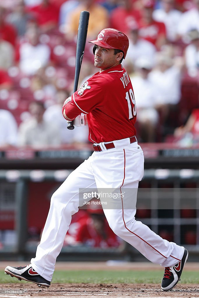 Joey Votto #19 of the Cincinnati Reds singles in the first inning in his first at bat since July 15 during the game against the Philadelphia Phillies at Great American Ball Park on September 5, 2012 in Cincinnati, Ohio. The Phillies won 6-2.