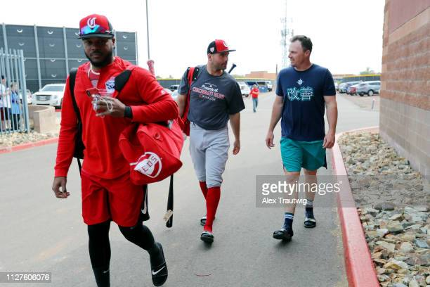 Joey Votto of the Cincinnati Reds speaks with Jay Bruce of the Seattle Mariners ahead of a Spring Training game on Monday February 25 2019 at Peoria...